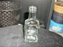 COLLECTABLE GLASS BOTTLE SLIGHT GREEN HUE SCREW WITH SLANT SHOULDERS